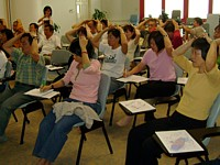 Participants learning where and how to massage their acupressure points